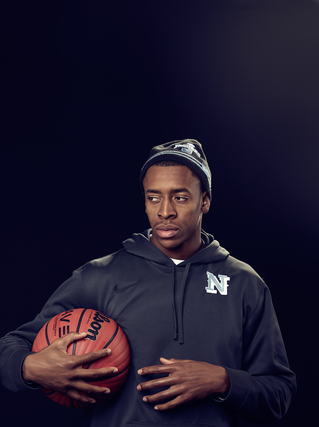 BBall-player-holding-ball-_-Michael-J-Moore-Photography